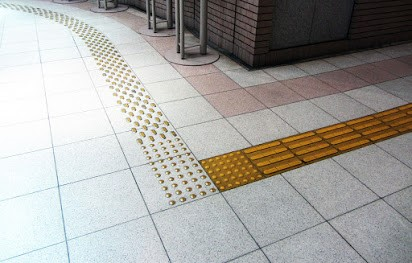 Tactile pavers in flooring are used to direct the specially abled